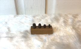 Mini gewichtjes in houten blokje