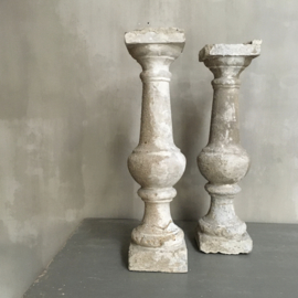 BU20110091 Set of 2 old French concrete balusters. Beautifully weathered clay color. The left baluster has an old crack on the base (see photo 7), by normal it won't be any problem. Size: +/- 61 cm. high / 15 wide. Pickup only!