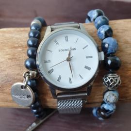 Blauw met zilveren quartz horloge met een magneetsluiting op de band.