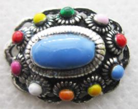 ZB015-MC middelgrote ovale zeeuwse knop zwaar verzilverd met in het oog springende  kleuren emaille.