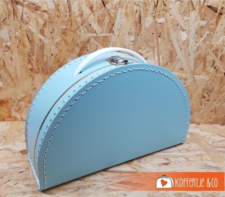 Halfrond licht blauw koffertje