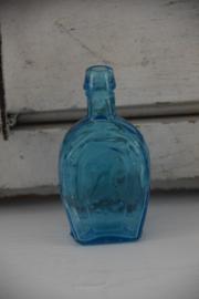 Vintage oud blauw glazen flesje Horse shoe
