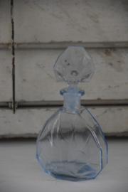 Blauw glazen parfumfles
