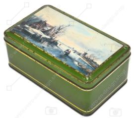 Grüne Vintage Keksdose mit einer holländischen Szene in einer Winterlandschaft