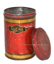 Old red French storage tin for sugar labeled SUCRE