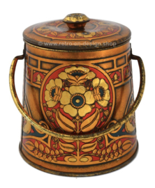 Cocoa tin in the shape of a bucket with handle and lid, with embossed flowers and butterflies for Wessanen Cocoa