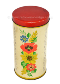 Cylindrical yellow vintage biscuit tin from Verkade, with coloured flowers