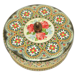Round vintage cookie tin executed with beaded pattern