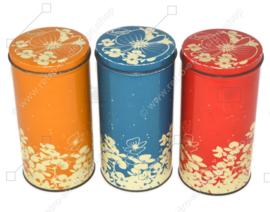 Juego vintage de tres latas de galletas Hooimeijer en rojo, naranja y azul