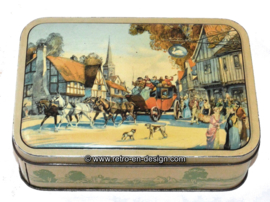 Vintage tin with horses and carriage in village scene