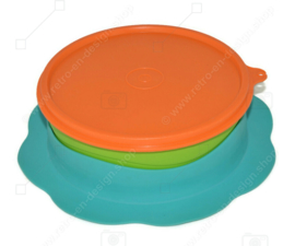 Toddler plate made by Tupperware in orange, green and blue