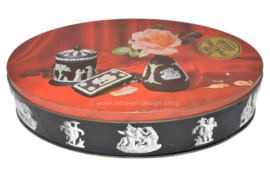 Carr's vintage oval tin with Wedgwood tableware and rose