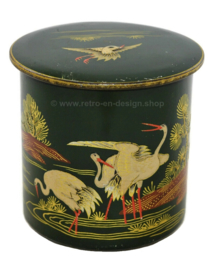 Round green vintage tin canister decorated with cranes