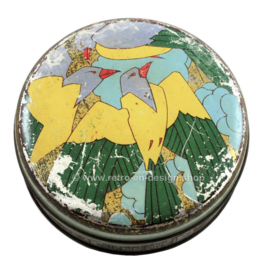 Round vintage candy tin with stylized birds