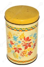 Lata de galletas vintage con estampado de flores estilizadas en rojo, amarillo y azul