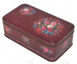 Rechteckige Vintage dunkelrote Blechdose mit mehrfarbigem Blumenmuster und Knistern