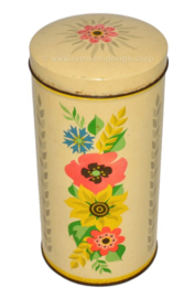 Cylindrical yellow vintage biscuit tin by Verkade, with colored flowers.