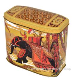 Lata de té vintage que representa un jinete y un elefante asiático