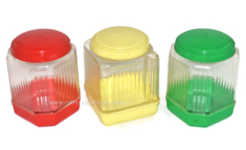 Vintage 60s plastic BK storage canisters in red, yellow and green