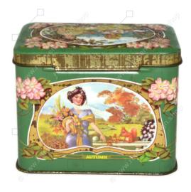 Vintage bonbonblik met afbeeldingen vier seizoenen en nostalgische dames