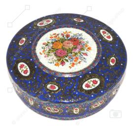 Vintage runde Blechdose, sogenannte Perlendose für Kekse. In Blau