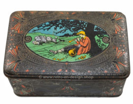 Vintage tin with drawing of shepherd in landscape