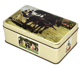 Vintage grey tin with color pictures of Frisian subjects