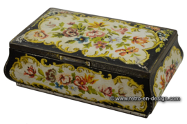 Vintage curved tin with flower decoration
