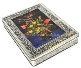 Vintage rectangular tin with flowers in vase made by Patria Quality Biscuits