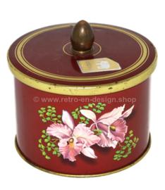 Bote de hojalata vintage con pomo y flor rosa con mortero amarillo de Côte d'Or