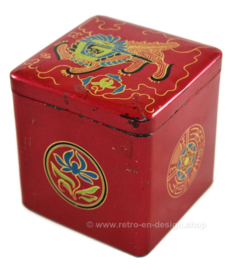 Vintage tin cube for tea by Van Nelle with a stylized image of an oriental lion