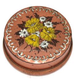 Runde Vintage Blech Schokoladendose mit Blumenstrauß