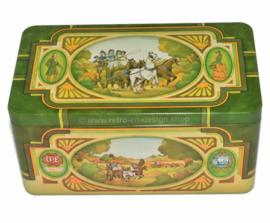 Boîte vintage pour le thé Pickwick par Douwe Egberts avec l'image de l'entraîneur, des chevaux et de l'auberge