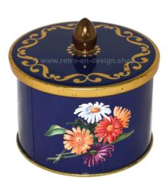Lata vintage azul con pomo y decoración floral de gerberas de Côte d'Or