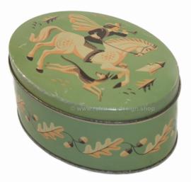 Ovale blikken koektrommel van Verkade Zaandam met paard, ruiter en jachthond.