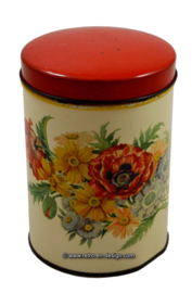 Vintage round tin with flowers