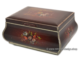 Red vintage drum or tea tin in belly model with carriage decor by DOUWE EGBERTS