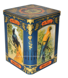 Tin drum by Van Melle fudge with images of different tropical birds on three sides