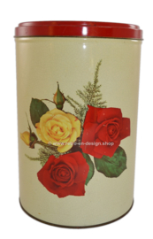 Vintage round tin drum with roses on craquelure surface