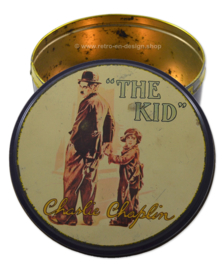 "Vintage round tin drum with image of Charlie Chaplin ""The Kid"""