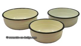 Set of three vintage enamel bowls, white with green border