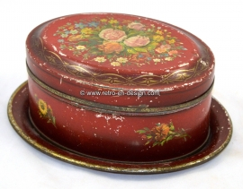 Brocante old tin box with plate in deep red colors