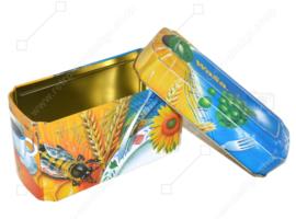 Oranje met blauwe blikken doos voor Crackers van Wasa met afbeelding van haan, bij, zonnebloem, graan en fruit