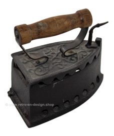 Antique metal coal iron with wooden handle