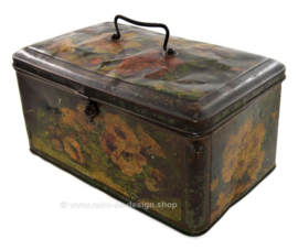 Large vintage tin with handle and decorated with painted flowers