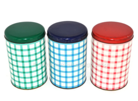Set of three checkered tin boxes in red, green and blue for Tomado