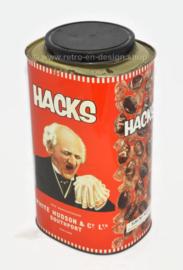 Groot rood vintage HACKS blik met niesende man.
