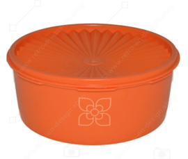 Vintage Tupperware biscuit tin with Servalier seal and stylized flower on the front