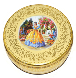 Vintage biscuit tin in romantic style with a woman in crinoline in flower garden