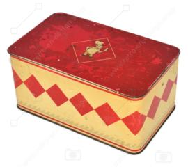 Boîte à biscuits Brocante fabriquée par Bolletje avec couvercle rouge et boulanger.